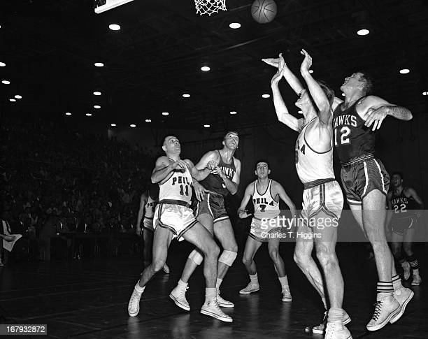 Jack Coleman of the St Louis Hawks shoots the ball against Neil Johnston of the Philadelphia Warriors during a game played on January 11 1956 at the...