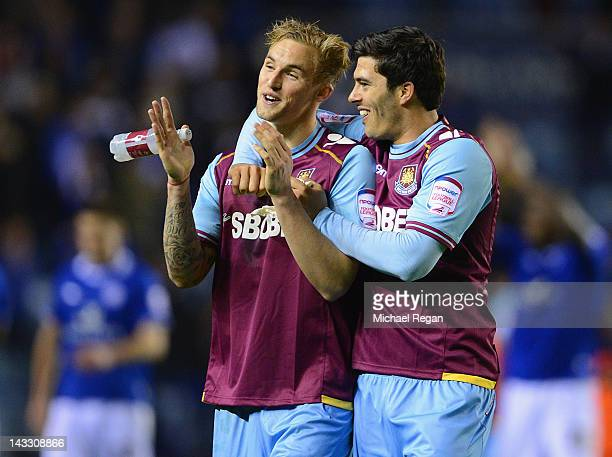 Jack Collison and James Tomkins of West Ham celebrate winning the npower Championship match between Leicester City and West Ham United at The King...