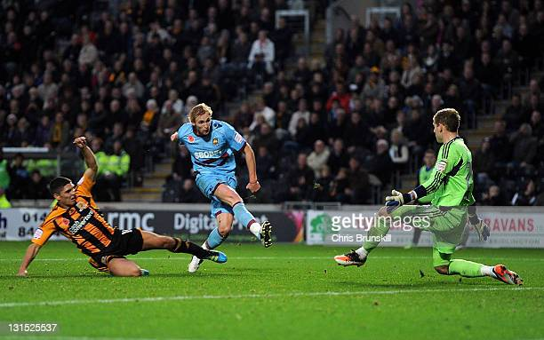 Jack Collison of West Ham United scores his side's second goal past Peter Gulacsi of Hull City during the npower Championship match between Hull City...