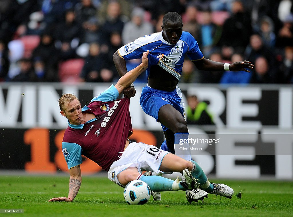 Jack Collison of West Ham United tangles with Mohamed Diame of Wigan Athletic during the Barclays Premier League match between Wigan Athletic and West Ham United at the DW Stadium on May 15, 2011 in Wigan, England.