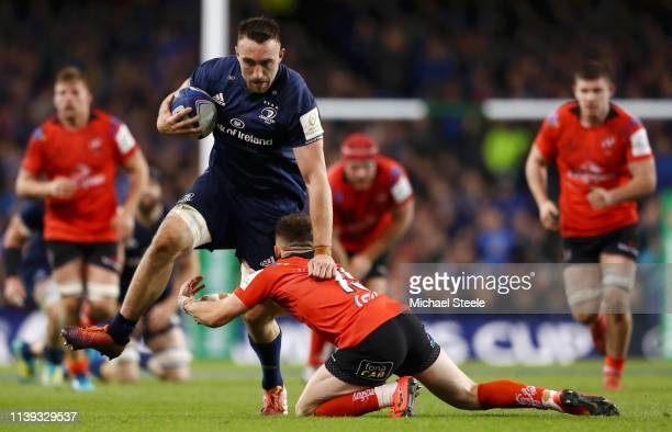 Jack Conan of Leinster breaks the tackle of Michael Lowry of Ulster during the Champions Cup Quarter Final match between Leinster Rugby and Ulster...