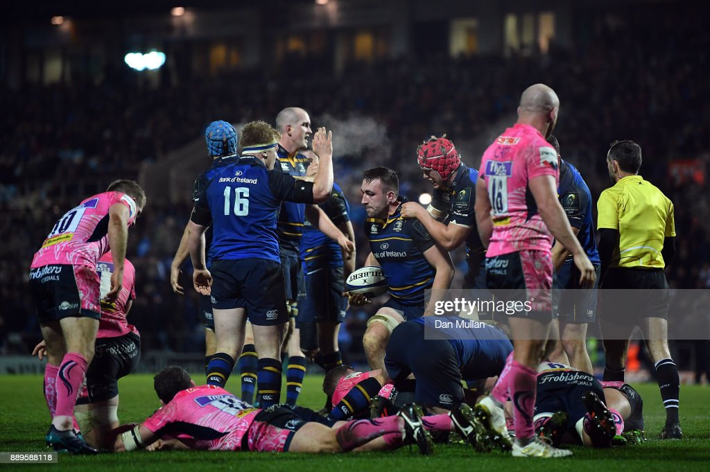 Jack Conan of Leinster (c) is congratulated by his team mates after scoring his side's secondtry during the European Rugby Champions Cup match between Exeter Chiefs and Leinster Rugby at Sandy Park on December 10, 2017 in Exeter, England.