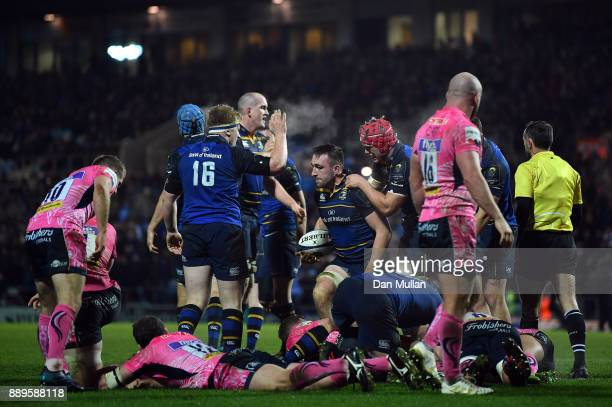 Jack Conan of Leinster is congratulated by his team mates after scoring his side's secondtry during the European Rugby Champions Cup match between...