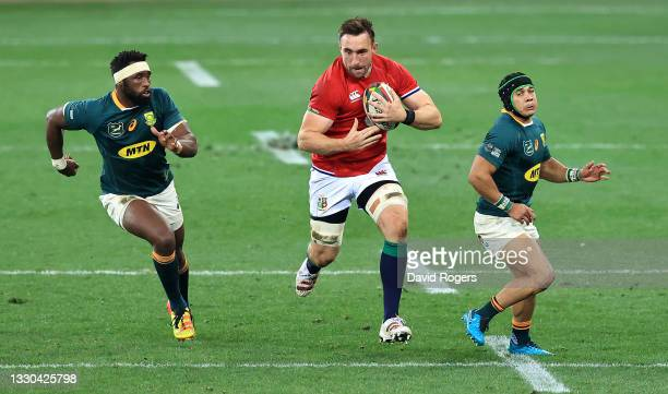 Jack Conan of the British & Irish Lions takes Siya Kolisi and Cheslin Kolbe during the 1st Test match between the South Africa Springboks and the...