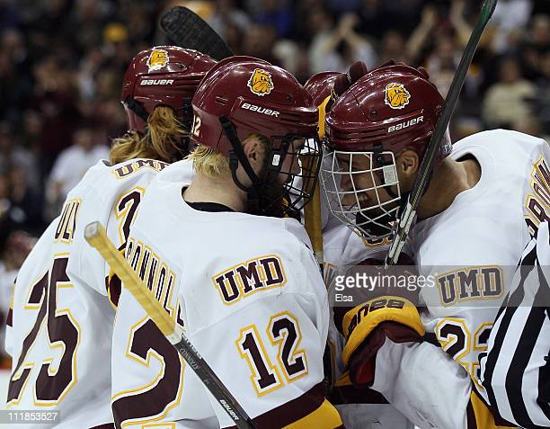 Jack Connolly of the Minnesota Duluth Bulldogs is congratulated by teammate JT Brown after Connolly scored in the second period against the Notre...