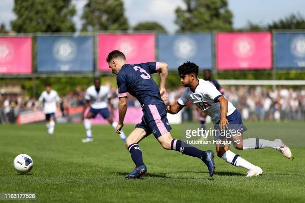 Jack Connors of Dulwich Hamlet is challenged by Dilan Markanday of Tottenham Hotspur during the PreSeason Friendly match between Dulwich Hamlet and...