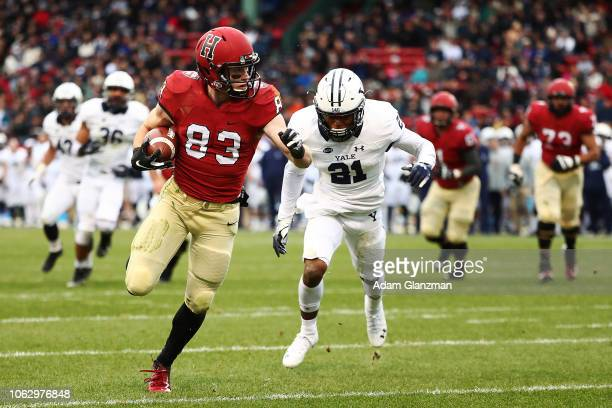 Jack Cook of the Harvard Crimson scores a touchdown during a game against the Yale Bulldogs at Fenway Park on November 17, 2018 in Boston,...