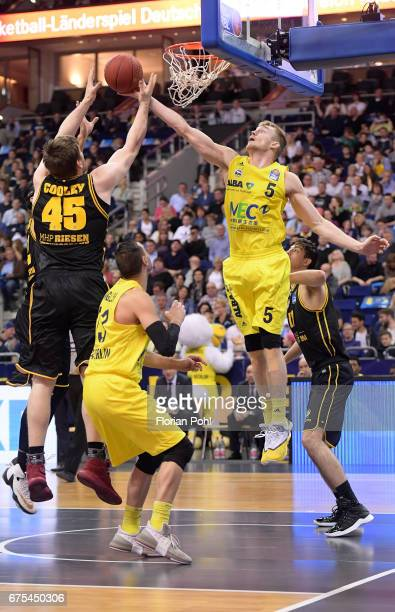 Jack Cooley of the MHP Riesen Ludwigsburg Malcolm Miller and Niels Giffey of Alba Berlin during the game between Alba Berlin and MHP Riesen...