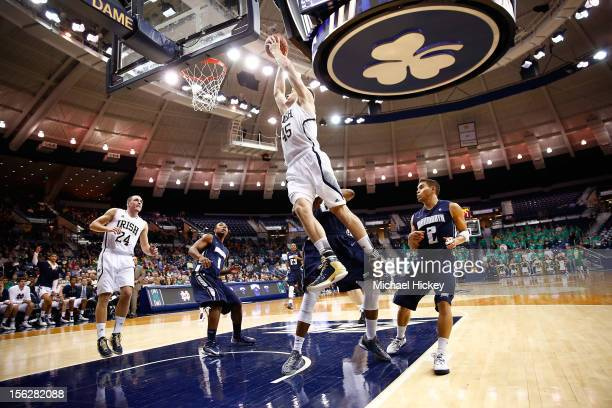 Jack Cooley of the Notre Dame Fighting Irish flies through the air to dunk against the Monmouth Hawks at Purcel Pavilion on November 12 2012 in South...