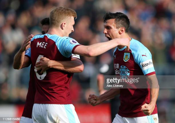Jack Cork and Ben Mee of Burnley celebrate following the Premier League match between Burnley FC and Tottenham Hotspur at Turf Moor on February 23...
