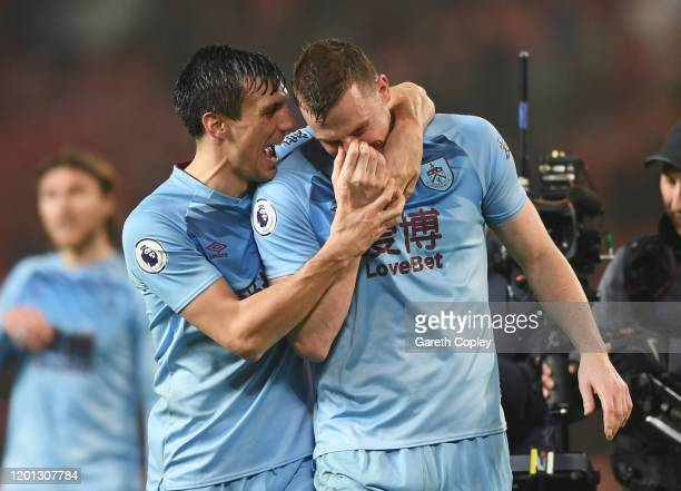 Jack Cork and Chris Wood of Burnley celebrate victory after the Premier League match between Manchester United and Burnley FC at Old Trafford on...