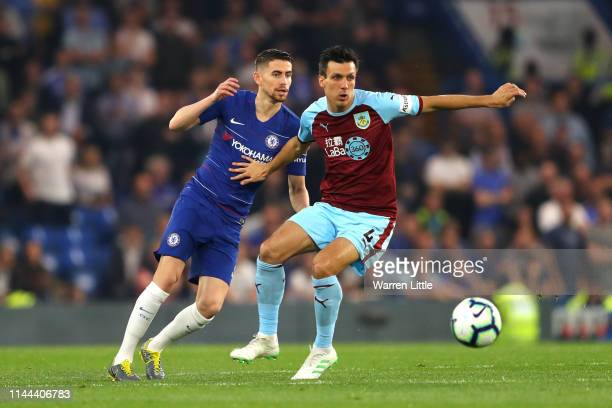 Jack Cork and Jorginho of Chelsea battle for possesion during the Premier League match between Chelsea FC and Burnley FC at Stamford Bridge on April...