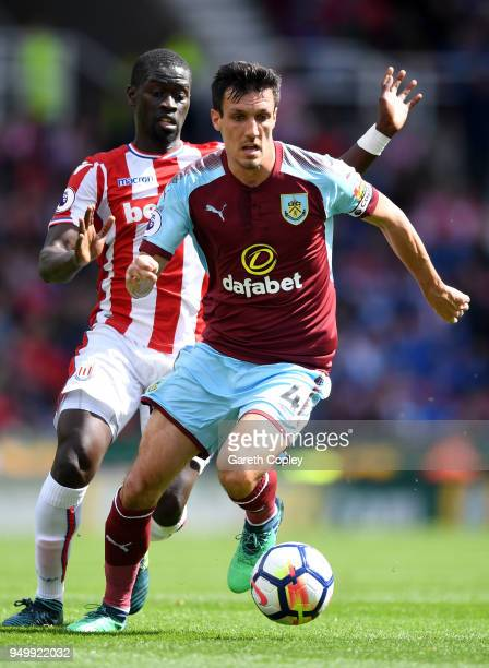 Jack Cork of Burnley and Badou Ndiaye of Stoke City in action during the Premier League match between Stoke City and Burnley at Bet365 Stadium on...