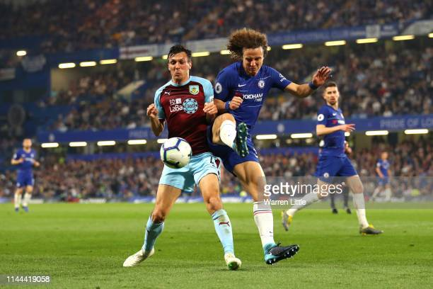 Jack Cork of Burnley and David Luiz of Chelsea battle for possession during the Premier League match between Chelsea FC and Burnley FC at Stamford...
