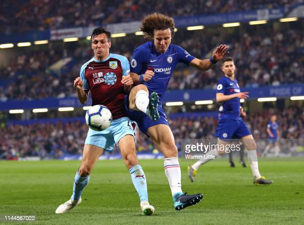 Jack Cork of Burnley and David Luiz of Chelsea battle for possession of the ball during the Premier League match between Chelsea FC and Burnley FC at...