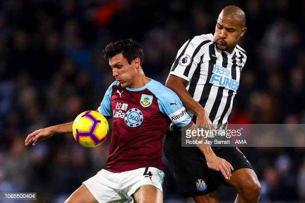 Jack Cork of Burnley and Jose Salomon Rondon of Newcastle United during the Premier League match between Burnley FC and Newcastle United at Turf Moor...