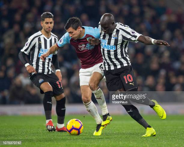Jack Cork of Burnley and Mohamed Diame of Newcastle United in action during the Premier League match between Burnley FC and Newcastle United at Turf...