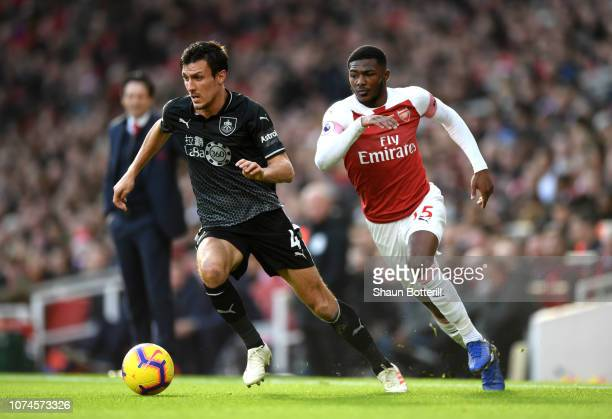 Jack Cork of Burnley is challenged by Ainsley MaitlandNiles of Arsenal during the Premier League match between Arsenal FC and Burnley FC at Emirates...