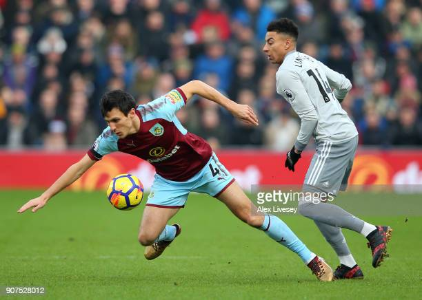 Jack Cork of Burnley is fouled by Jesse Lingard of Manchester United during the Premier League match between Burnley and Manchester United at Turf...