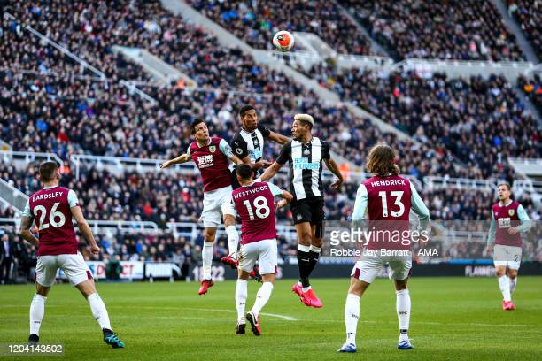 Jack Cork of Burnley Isaac Hayden and Joelinton of Newcastle United challenge for a header during the Premier League match between Newcastle United...
