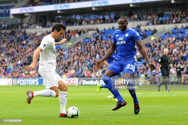 Jack Cork of Burnley vies for possession with Souleymane Bamba of Cardiff City during the Premier League match between Cardiff City and Burnley at...
