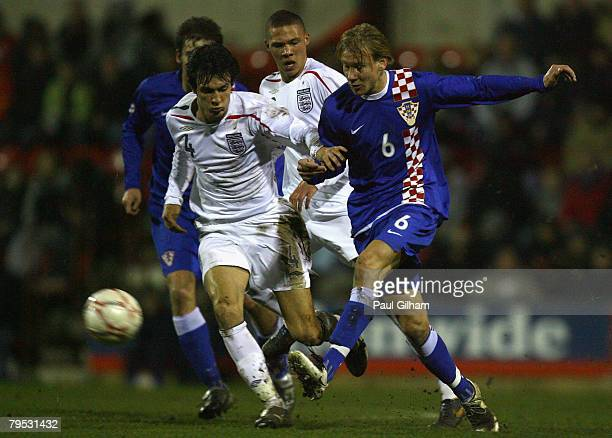 Jack Cork of England battles for the ball with Domagoj Vida of Croatia during the U19 international match between England U19's and Croatia U19's at...