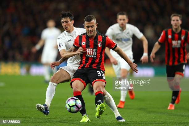 Jack Cork of Swansea City and Jack Wilshere of AFC Bournemouth battle for possession during the Premier League match between AFC Bournemouth and...