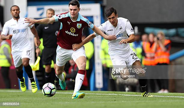 Jack Cork of Swansea City and Michael Keene of Burnley during the Premier League match between Burnley and Cardiff City at Turf Moor on August 13...