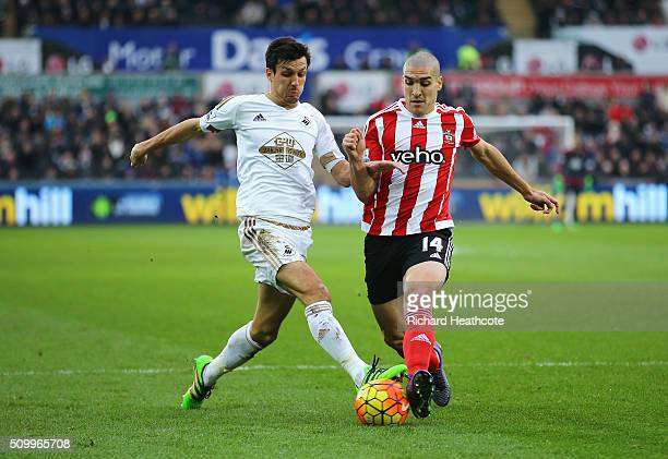Jack Cork of Swansea City and Oriol Romeu of Southampton compete for the ball during the Barclays Premier League match between Swansea City and...