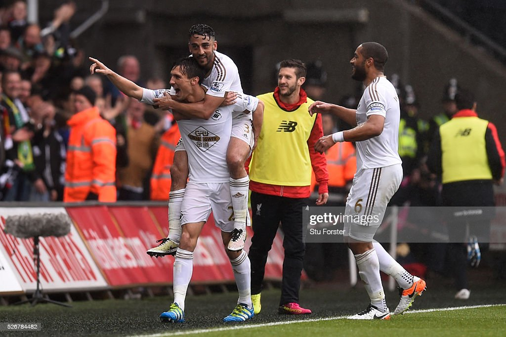 Jack Cork of Swansea City celebrates scoring his team's second goal with Neil Taylor and Ashley Williams (R) during the Barclays Premier League match between Swansea City and Liverpool at The Liberty Stadium on May 1, 2016 in Swansea, Wales.