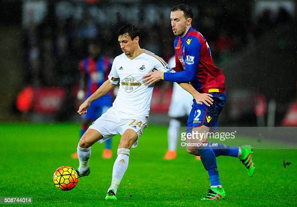 Jack Cork of Swansea City holds off Jordon Mutch of Crystal Palace during the Barclays Premier League match between Swansea City and Crystal Palace...