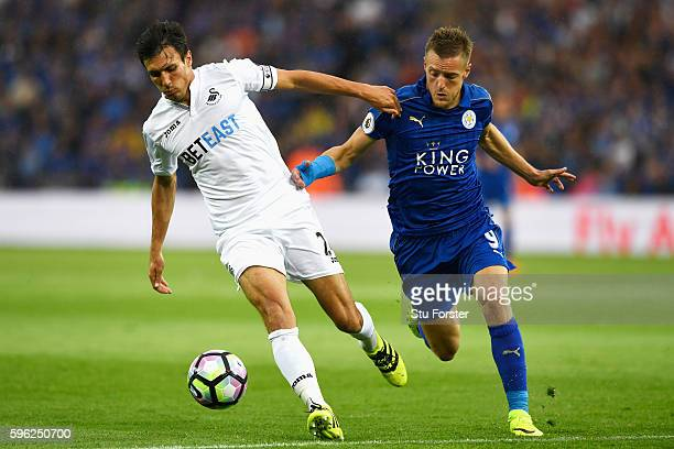 Jack Cork of Swansea City is chased by Jamie Vardy of Leicester City during the Premier League match between Leicester City and Swansea City at The...