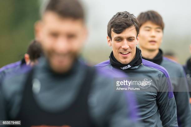 Jack Cork of Swansea City looks on during the Swansea City training session at The Fairwood training Ground on March 15 2017 in Swansea Wales
