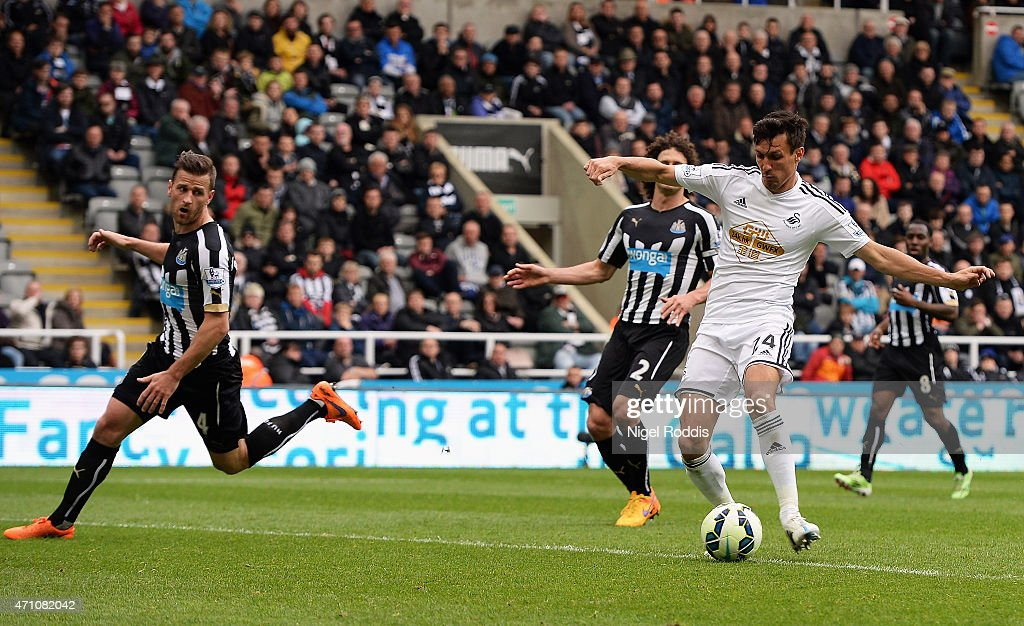 Jack Cork of Swansea City scores their third goal during the Barclays Premier League match between Newcastle United and Swansea City at St James' Park on April 25, 2015 in Newcastle upon Tyne, England.