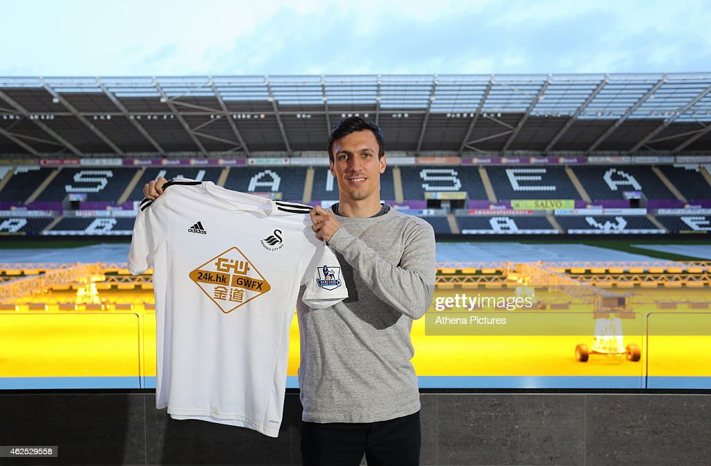 Jack Cork signs for Swansea City at Liberty Stadium on January 30, 2015 in Swansea, Wales.