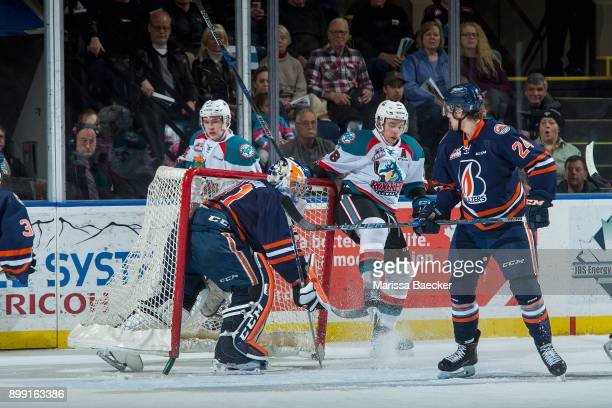 Jack Cowell of the Kelowna Rockets is checked into the net of Dylan Ferguson by Luc Smith of the Kamloops Blazers during first period action on...
