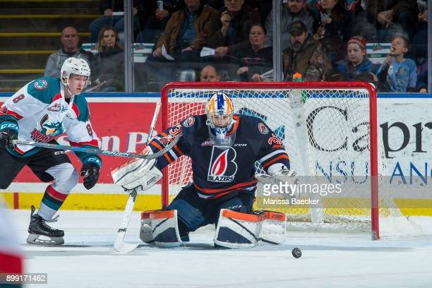 Jack Cowell of the Kelowna Rockets skates for the puck after a deflection by Dylan Ferguson of the Kamloops Blazers during second period on December...