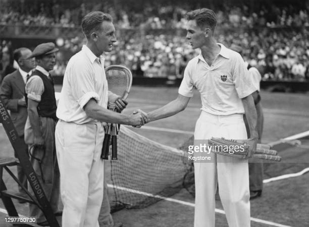 Jack Crawford of Australia shakes hands and is congratulated by Ellsworth Vines of the United States following their Men's Singles Final match at the...