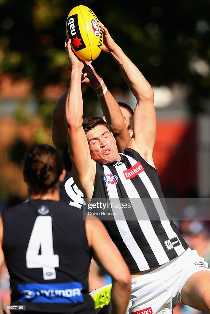Jack Crisp of the Magpies marks during the NAB Challenge AFL match between the Collingwood Magpies and the Carlton Blues at Queen Elizabeth Oval on March 15, 2015 in Bendigo, Australia.