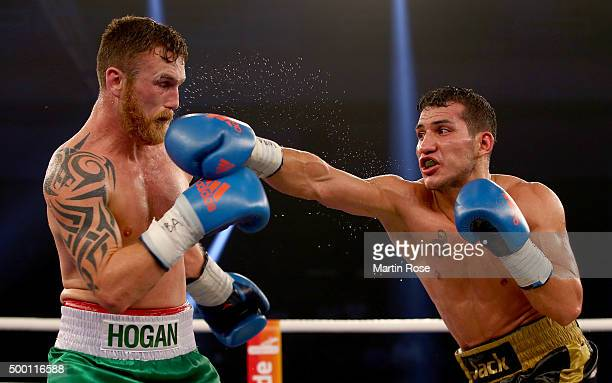 Jack Culcay of Germany and Dennis Hogan of Ireland exchange punches during the WBA World Championship Light Middleweight title fight at...