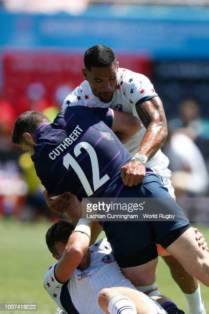 Jack Cuthbert of Scotland is tackled by Martin Iosefo and Stephen Tomasin of the United States during their match on day three of the Rugby World Cup...
