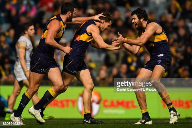 Jack Darling Jack Redden and Josh Kennedy of the Eagles celebrates a goal during the 2017 AFL round 21 match between the West Coast Eagles and the...