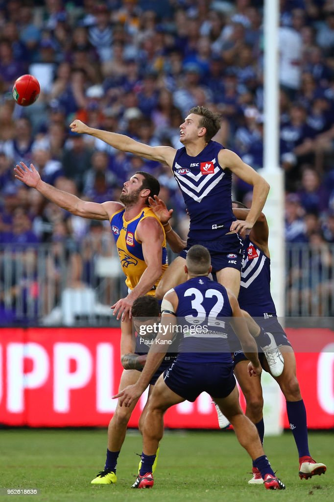 Jack Darling of the Eagles and Taylin Duman of the Dockers contest a mark during the Round 6 AFL match between the Fremantle Dockers and West Coast Eagles at Optus Stadium on April 29, 2018 in Perth, Australia.