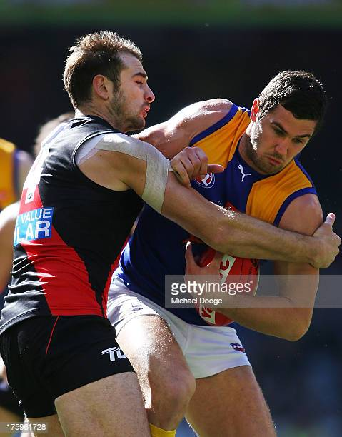 Jack Darling of the Eagles gets tackled by Jobe Watson of the Bombers during the round 20 AFL match between the Essendon Bombers and the West Coast...