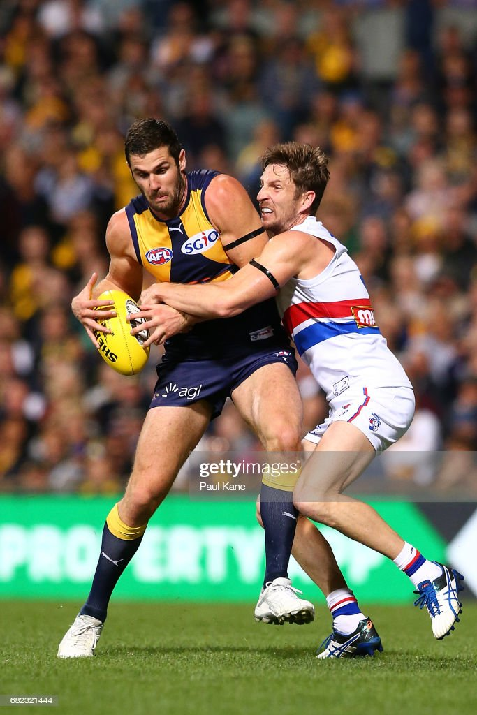 Jack Darling of the Eagles gets tackled by Matthew Boyd of the Bulldogs during the round eight AFL match between the West Coast Eagles and the Western Bulldogs at Domain Stadium on May 12, 2017 in Perth, Australia.