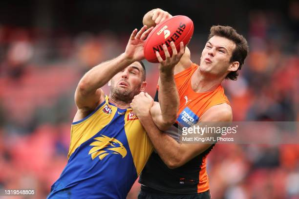 Jack Darling of the Eagles is competes for the ball against JackBuckley of the Giants during the round 10 AFL match between the Greater Western...