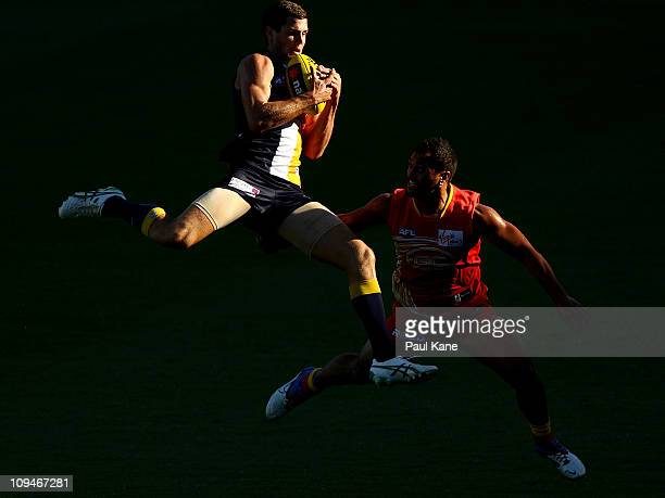 Jack Darling of the Eagles marks over Karmichael Hunt of the Suns during the NAB Cup Quarter Final match between the West Coast Eagles and the Gold...