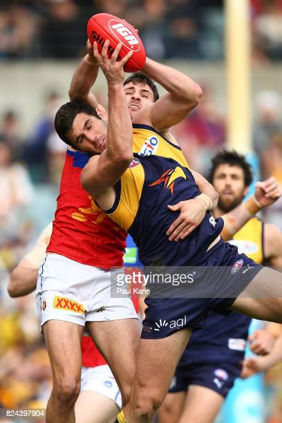 Jack Darling of the Eagles marks the ball against Sam Mayes of the Lions during the round 19 AFL match between the West Coast Eagles and the Brisbane...
