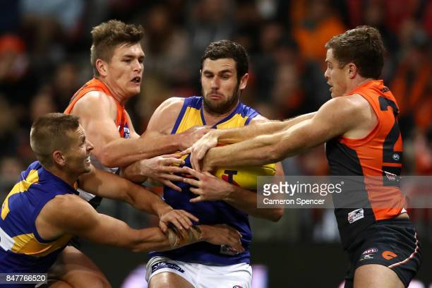 Jack Darling of the Eagles receives attention as he attempts to mark during the AFL First Semi Final match between the Greater Western Sydney Giants...