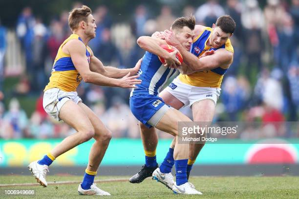 Jack Darling of the Eagles tackles Shaun Higgins of the Kangaroos during the round 19 AFL match between the North Melbourne Kangaroos and the West...